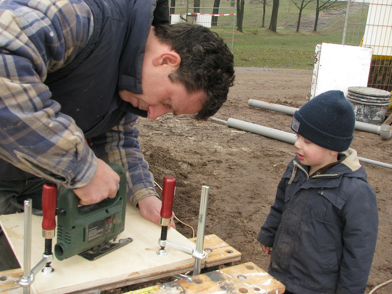 Sawing a hole with the saw machine. Stijn and dad Robert working on a connection plate