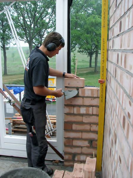 Erik bricklaying around the doors of the bedroom