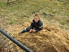 Stijn is playing with the fresh yellow soil