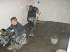 Toine Adriaans and Hans van Dommelen are washing in the cellar floor (Avedo tegelwerken)