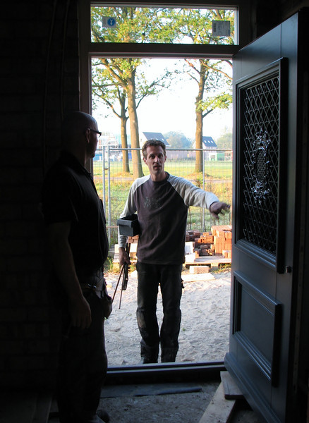 Fixing the front door by firm van der Linden and Erick visiting the house