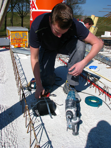 Electrician student Niels mounting the light spots