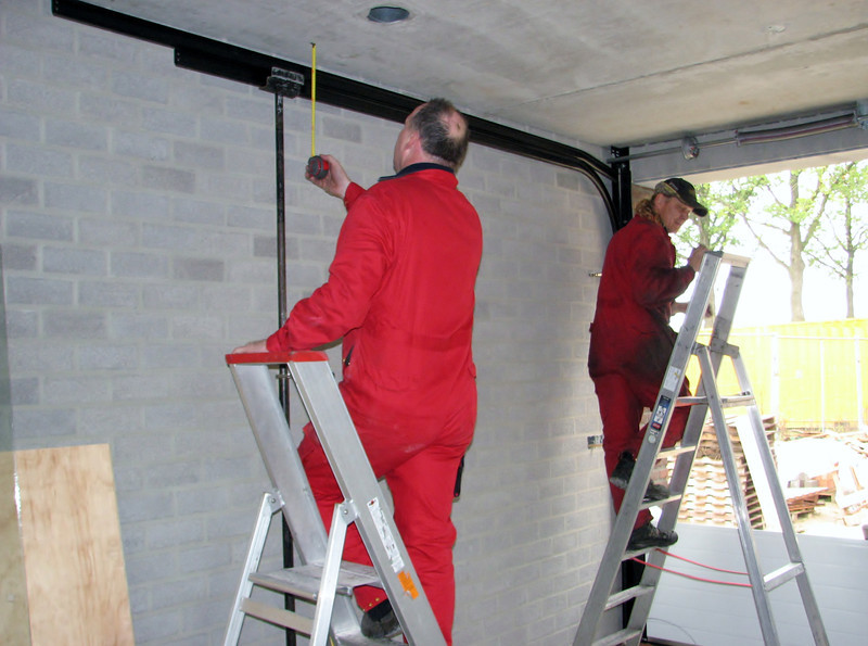 Gino and fellow-worker installing the automatic garage door