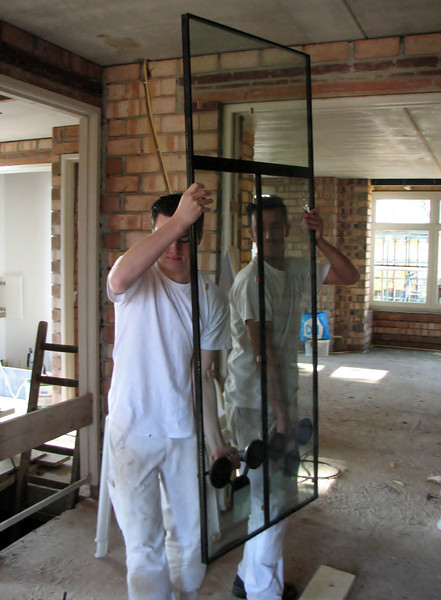Robert and Rick setting glass (Robert van de Wetering Paint- and Glass works)