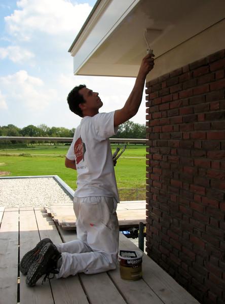 Robert (firm Robert van de Wetering paintwork) painting the bottom of the gutter