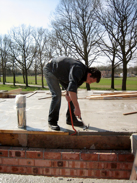 Robert break up the scaffolding planks a day after concrete casting