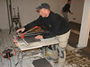 Hans Adriaans is cutting the tiles (Avedo tegelwerken)