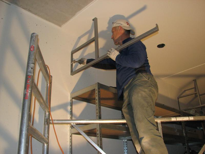 Marijn mounting racks in the garage cellar