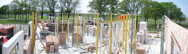 Scaffolding and supplying bricks