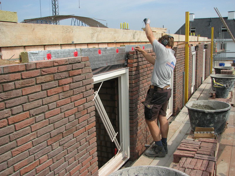 Paul bricklaying the upright course above the windows in the Eastern wall