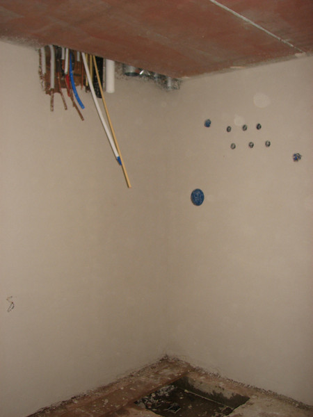 Plastering the cellar walls