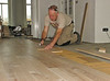 Robert and Marijn laying the oak parquet in the living room