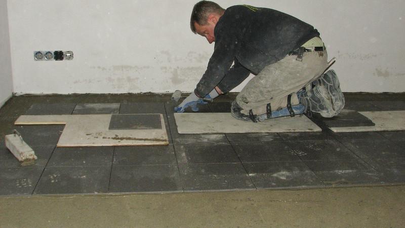 Avedo tegelwerken tiling the cellar floor