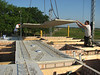 Laying the concrete floor bottoms with a crane