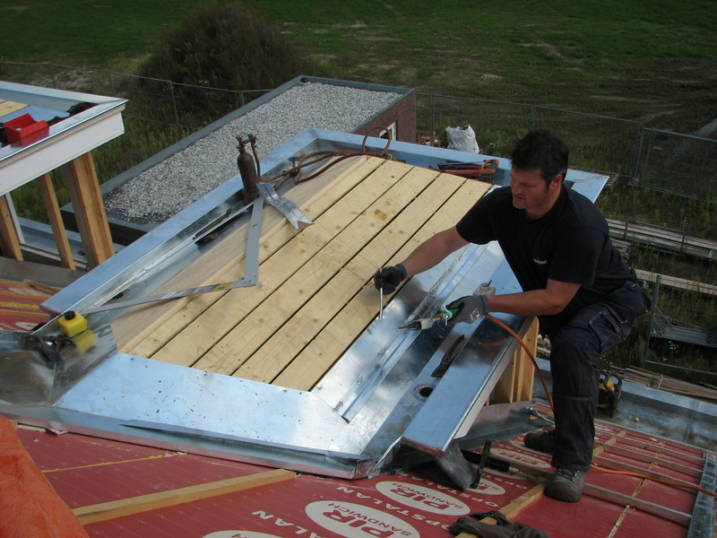 Coen Lokker soldering the zinc roof parts