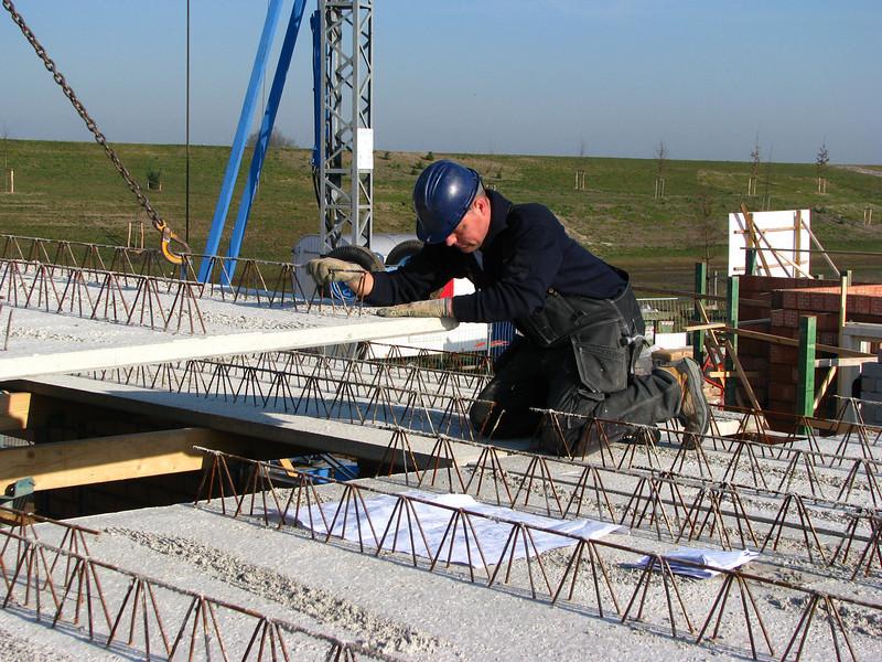 Hans co-ordinate laying concrete floor bottoms