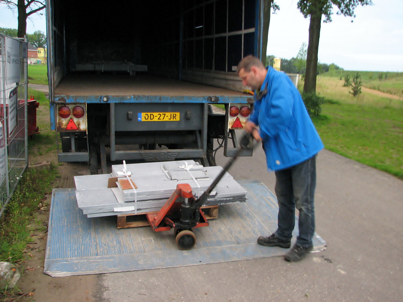 Frans transporting Ardennes blue stone building parts from Arendonk Belgium
