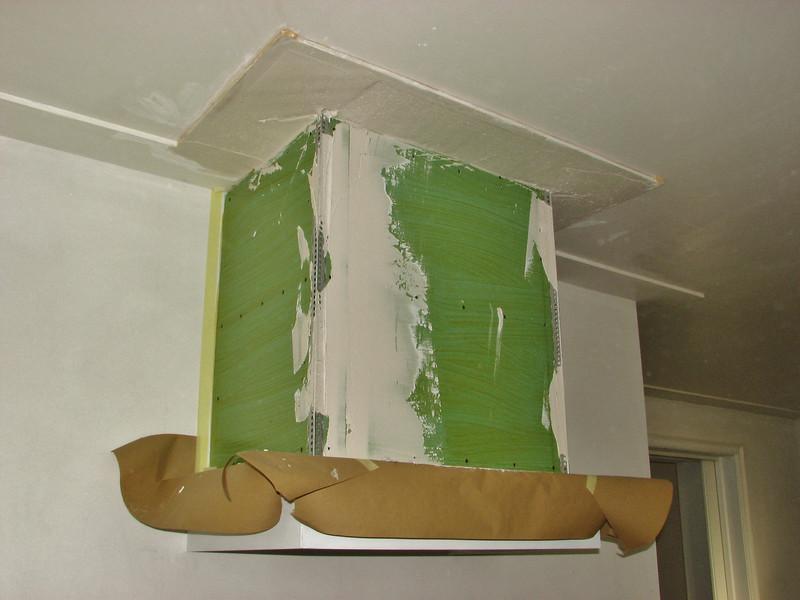 plastering the edges of the mantelshelf