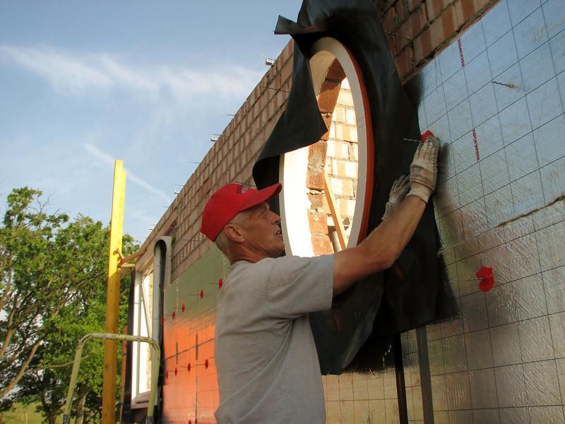 Marijn insulating the South wall