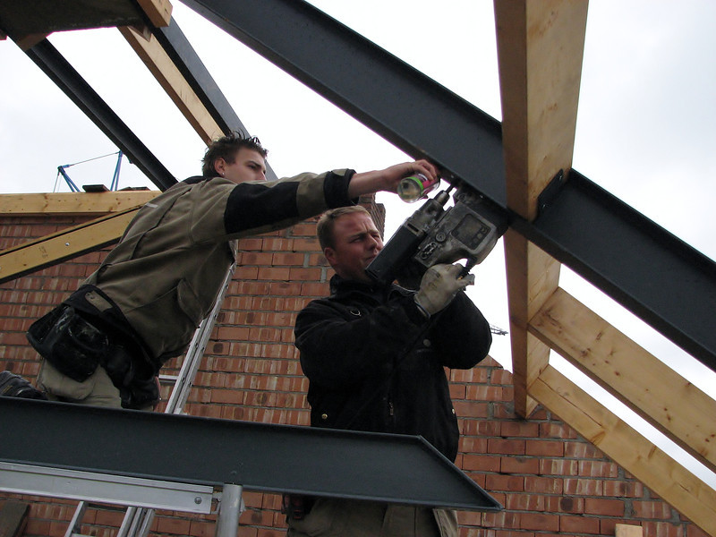 Drilling holes to assemble a steel beam for an attic