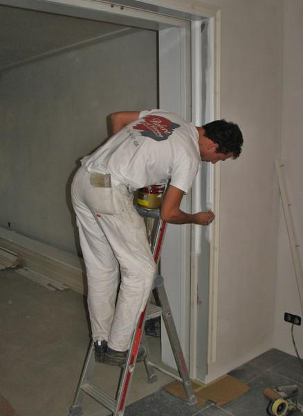 Robert is painting the sliding door frame