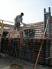 Paul finishing bricklaying of the first floor walls