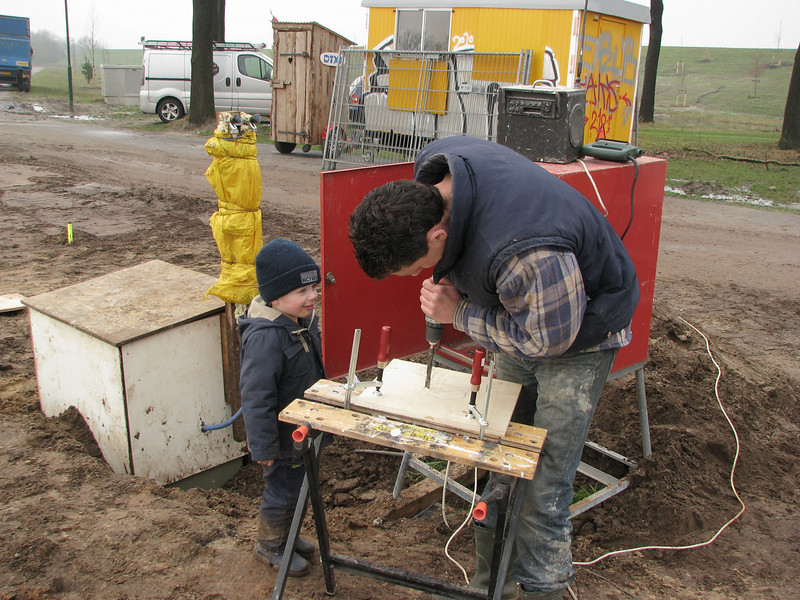 Drill a hole. Stijn and dad Robert working on a sewer connection plate