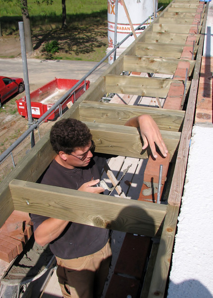 Twan bricklaying between the gutter beams