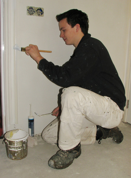 "Rick ""Rambo"" is painting the door frames (firm Robert v.d. Wetering)"