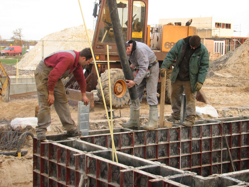 Team work, pour concrete around the air-tubes and measure the wall hight