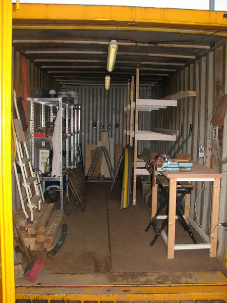 """Container, storage of building material <br /> Racks, bench and lighting are made of Henk Kemps """"zund"""" (shame)"""