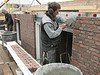 Paul making the brickupright course above the bedroom doors of the West wall