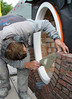 Paul bricklaying the upright course of the oval window