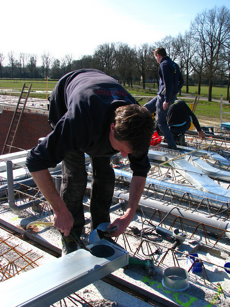 Erick, (registered fitter, E.v.d. Linden)busy with installation of the ventilation tubes