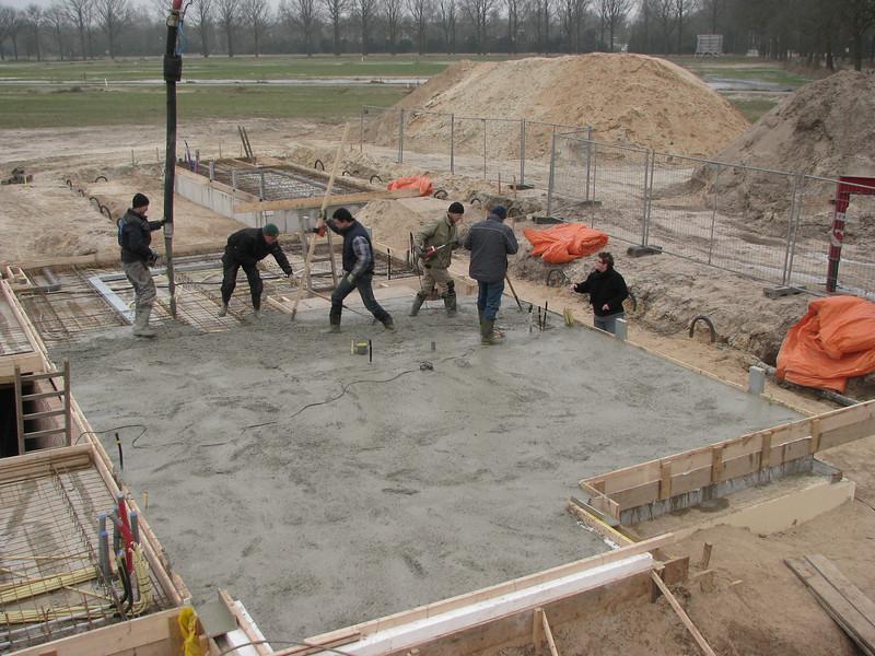 Casting team in action. Casting concrete
