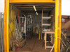 "Container, storage of building material <br /> Racks, bench and lighting are made of Henk Kemps ""zund"" (shame)"