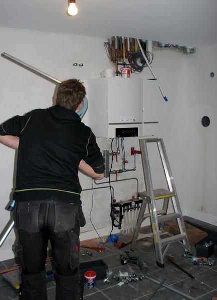 Erick installing the central-heating boiler (CH) (firm E. v.d. Linden