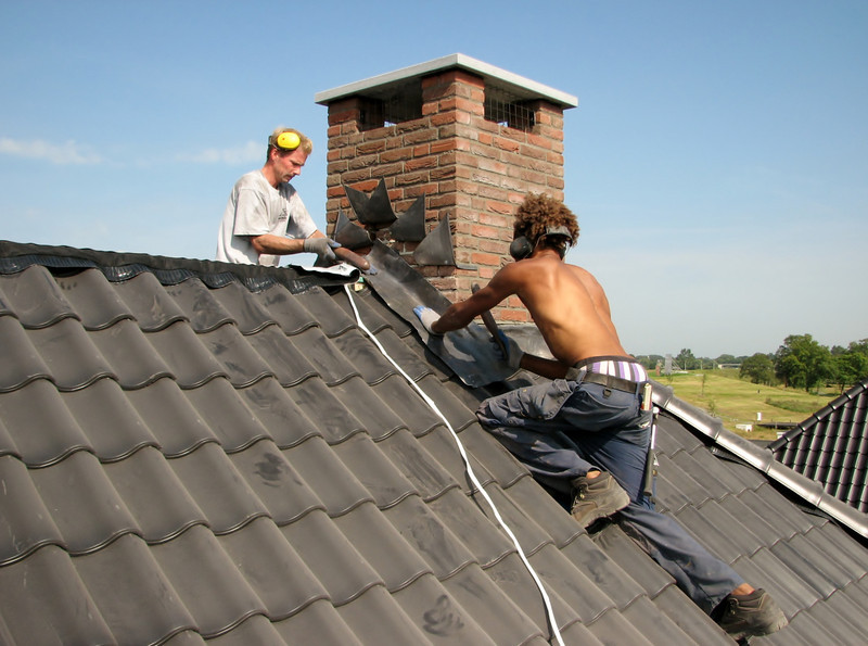 Lead sheets mounting against water penetration. Tilers roofing tiles