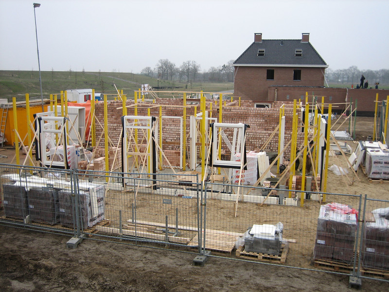 View at the South side of the house. Bricklaying the interior walls on the ground floor