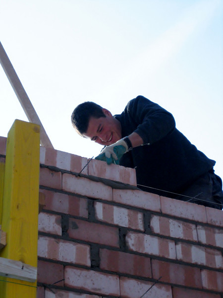 Bricklaying the inner walls of the first floor by Erik