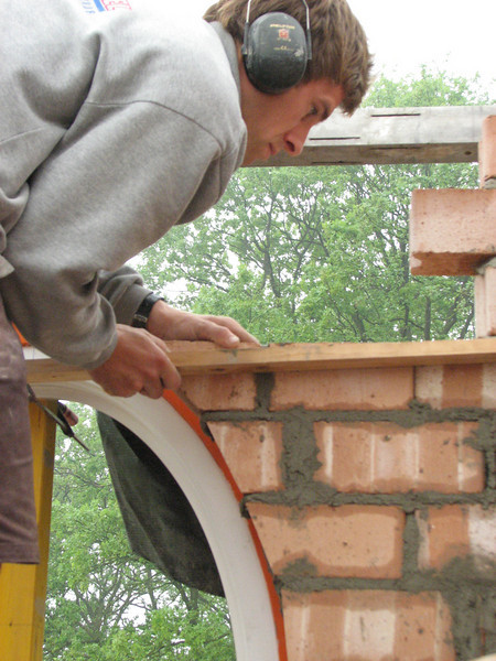 Paul bricklaying the oval window in the inner wall