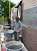 Erik and Paul van Gastel bricklaying the upright course