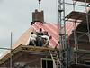 Hoisting the roof insulation boards with a crane