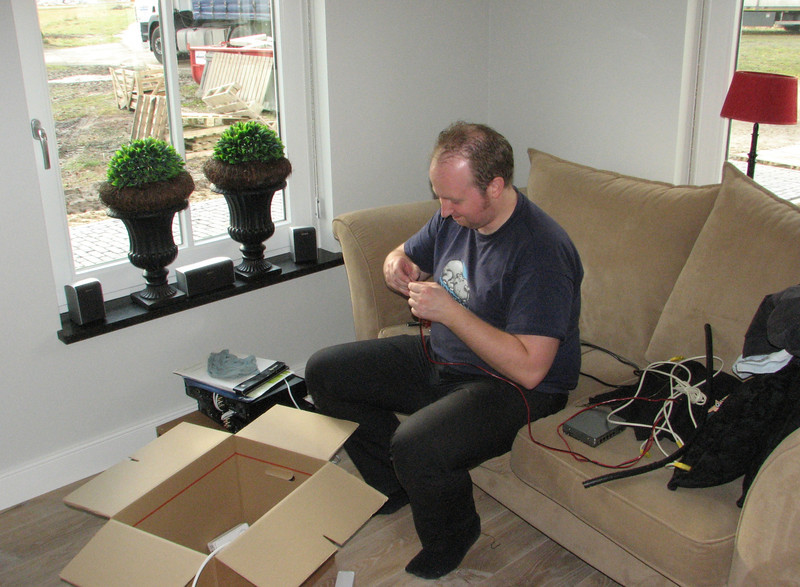 Jeroen is making electrical connections of audio/video equipment