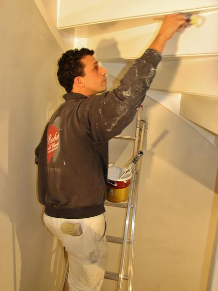 Robert is lacquering the stair to the attic (firm Robert v.d. Wetering schilderwerken)