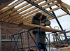 Jarno making up wooden beams for an attic