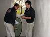 Robert and Rick mounting the ovale pane (firm: Robert van de Wetering glas- en schilderwerken)