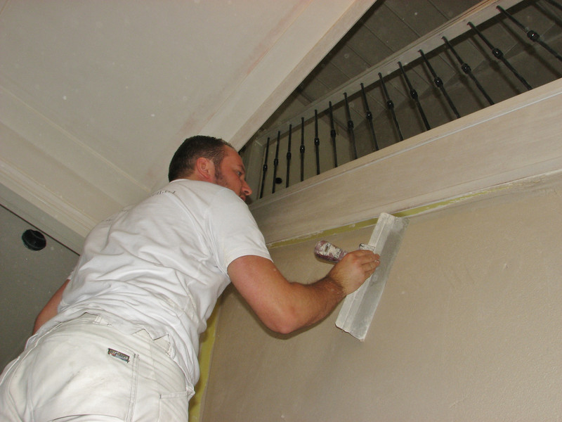 Martien is plastering the stair wall