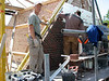 """Paul and Twan bricklaying the upright course (NL: """"boerenvlecht"""") of the gable"""