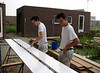 Robert and Rick priming wood of the gutter